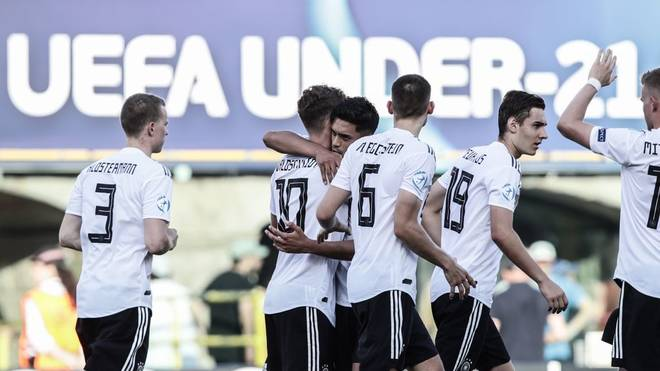 Germany's forward Luca Waldschmidt (C-L) celebrates with Germany's midfielder Nadiem Amiri (C) after Waldschmidt scored a penalty during the semi-final match of the U21 European Football Championships between Germany and Romania on June 27, 2019 at the Renato Dall'Ara stadium in Bologna. (Photo by Isabella BONOTTO / Update Images Press / AFP)        (Photo credit should read ISABELLA BONOTTO/AFP/Getty Images)