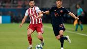 Olympiakos' Greek midfielder Giorgios Masouras (L) fights for the ball with Bayern Munich's German midfielder Joshua Kimmich during the UEFA Champions League group B football match between Olympiacos FC and FC Bayern Munchen on October 22, 2019 at the Georgios Karaiskakis stadium in Piraeus near Athens, on October 22, 2019. (Photo by LOUISA GOULIAMAKI / AFP) (Photo by LOUISA GOULIAMAKI/AFP via Getty Images)