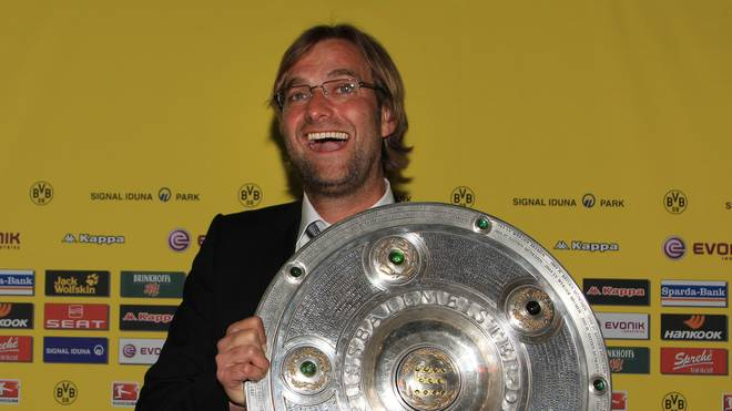 DORTMUND, GERMANY - MAY 14: Head coach Juergen Klopp poses with the German Championship trophy during the dinner to celebrate their German Bundesliga 2010/2011 victory on May 14, 2011 in Dortmund, Germany. (Photo by Pool/Bongarts/Getty Images)