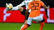 Germany's forward Timo Werner and Netherlands' Defender Denzel Dumfries vie for the ball during the UEFA Euro 2020 Group C qualification football match between Germany and the Netherlands in Hamburg, northern Germany, on September 6, 2019. (Photo by PATRIK STOLLARZ / AFP)        (Photo credit should read PATRIK STOLLARZ/AFP/Getty Images)