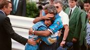 Benetton-Ford's team manager Flavio Briatore (R) hugs German driver Michael Schumacher after his victory in the Monaco Formula One Grand Prix on May 15, 1994. (Photo by Christophe SIMON / AFP)        (Photo credit should read CHRISTOPHE SIMON/AFP via Getty Images)