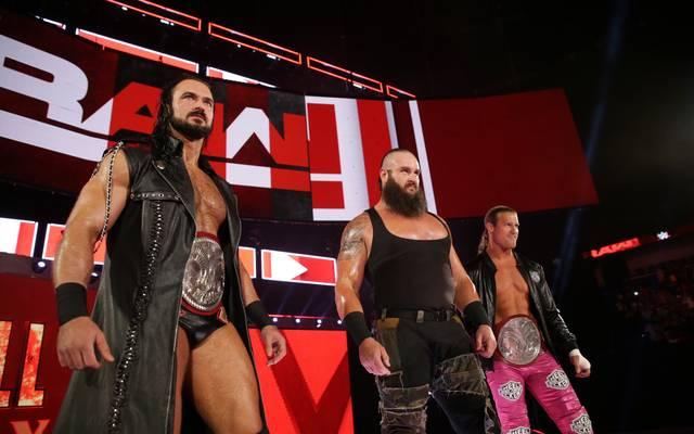 Bis vor kurzem noch Verbündete bei WWE: Drew McIntyre (l.) und Braun Strowman (M., mit Dolph Ziggler)