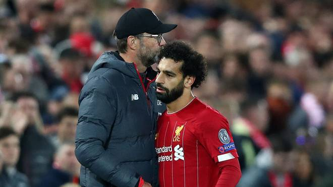 LIVERPOOL, ENGLAND - OCTOBER 02: Mohamed Salah of Liverpool embraces Jurgen Klopp, Manager of Liverpool after being substituted during the UEFA Champions League group E match between Liverpool FC and RB Salzburg at Anfield on October 02, 2019 in Liverpool, United Kingdom. (Photo by Clive Brunskill/Getty Images)