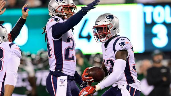 Devin McCourty of the New England Patriots is congratulated by his teammate Stephon Gilmore
