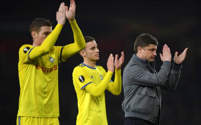 LONDON, ENGLAND - FEBRUARY 21: Aleksei Baga, Manager of FC BATE (R) applauds fans following defeat in the UEFA Europa League Round of 32 Second Leg match between Arsenal and BATE Borisov at Emirates Stadium on February 21, 2019 in London, United Kingdom. (Photo by Mike Hewitt/Getty Images)