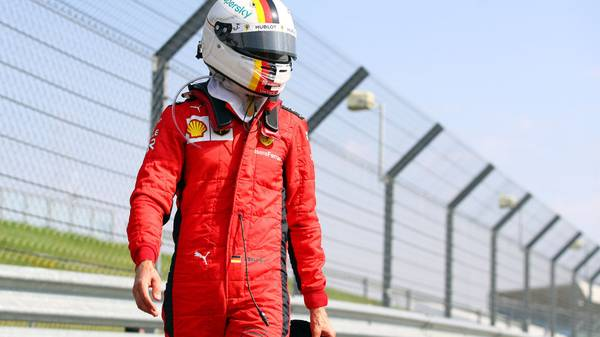 NORTHAMPTON, ENGLAND - AUGUST 09: Sebastian Vettel of Germany and Ferrari looks on in parc ferme during the F1 70th Anniversary Grand Prix at Silverstone on August 09, 2020 in Northampton, England. (Photo by Bryn Lennon/Getty Images)