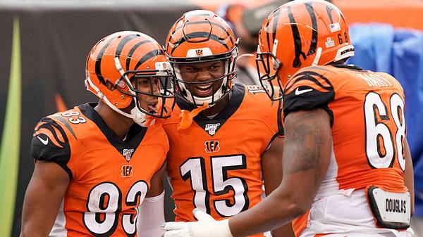 CINCINNATI, OHIO - OCTOBER 06: Tyler Boyd #83 celebrates with Damion Willis #15 and Bobby Hart #68 of the Cincinnati Bengals after scoring a touchdown during the NFL game against the Arizona Cardinals at Paul Brown Stadium on October 06, 2019 in Cincinnati, Ohio. (Photo by Bryan Woolston/Getty Images)