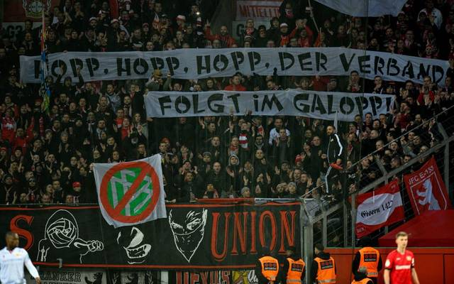 Union Berlin fans display banners criticising the German FA (DFB) during the German Cup (DFB Pokal) quarter-final football match Bayer Leverkusen v Union Berlin in Leverkusen, western Germanyon March 4, 2020. (Photo by SASCHA SCHUERMANN / AFP) / DFB REGULATIONS PROHIBIT ANY USE OF PHOTOGRAPHS AS IMAGE SEQUENCES AND QUASI-VIDEO. (Photo by SASCHA SCHUERMANN/AFP via Getty Images)