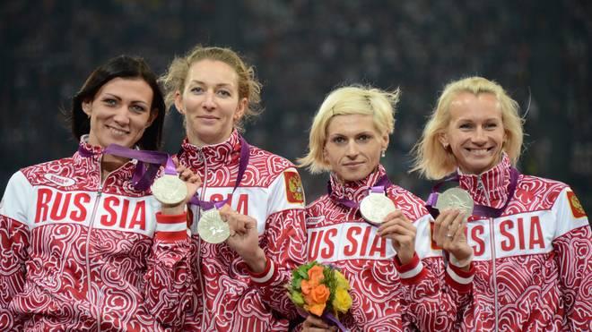Russia's silver medalists Tatyana Firova