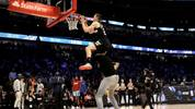 CHICAGO, ILLINOIS - FEBRUARY 15: Pat Connaughton #24 of the Milwaukee Bucks dunks the ball over Giannis Antetokounmpo in the 2020 NBA All-Star - AT&T Slam Dunk Contest during State Farm All-Star Saturday Night at the United Center on February 15, 2020 in Chicago, Illinois. NOTE TO USER: User expressly acknowledges and agrees that, by downloading and or using this photograph, User is consenting to the terms and conditions of the Getty Images License Agreement. (Photo by Jonathan Daniel/Getty Images)