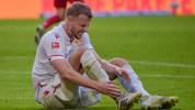Union Berlin's German defender Marvin Friedrich sits on the pitch with pain during the German First division Bundesliga football match between Bayern Munich and FC Union Berlin in Munich, on October 26, 2019. (Photo by Guenter SCHIFFMANN / AFP) / DFL REGULATIONS PROHIBIT ANY USE OF PHOTOGRAPHS AS IMAGE SEQUENCES AND/OR QUASI-VIDEO (Photo by GUENTER SCHIFFMANN/AFP via Getty Images)