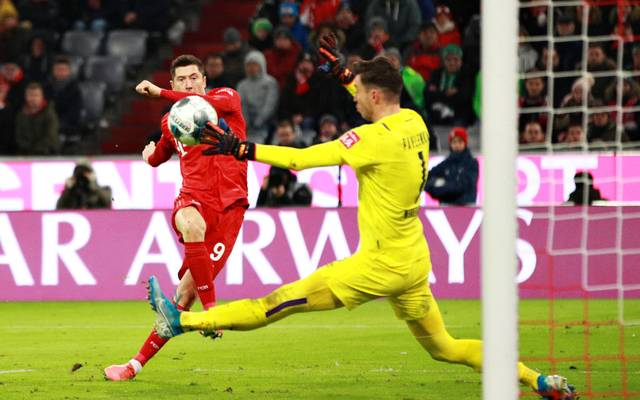 MUNICH, GERMANY - DECEMBER 14: Robert Lewandowski of FC Bayern Muenchen scores his sides fourth goal during the Bundesliga match between FC Bayern Muenchen and SV Werder Bremen at Allianz Arena on December 14, 2019 in Munich, Germany. (Photo by Adam Pretty/Bongarts/Getty Images)