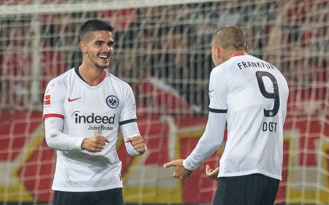 BERLIN, GERMANY - SEPTEMBER 27: Andre Silva of Eintracht Frankfurt celebrates with team mate Bas Dost of Eintracht Frankfurt after scoring his team's second goal  during the Bundesliga match between 1. FC Union Berlin and Eintracht Frankfurt at Stadion An der Alten Foersterei on September 27, 2019 in Berlin, Germany. (Photo by Boris Streubel/Bongarts/Getty Images)
