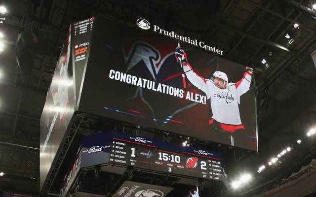 NEWARK, NEW JERSEY - FEBRUARY 22: Alex Ovechkin #8 of the Washington Capitals celebrates his goal at 4:50 of the third period against the New Jersey Devils at the Prudential Center on February 22, 2020 in Newark, New Jersey. With the goal, Ovechkin became the eight player in NHL history to score 700 goals. (Photo by Bruce Bennett/Getty Images)