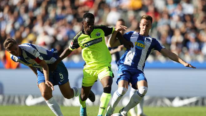 BERLIN, GERMANY - SEPTEMBER 21: Christopher Antwi-Adjej of SC Paderborn 07 takes on Niklas Stark and Lukas Klunter of Hertha BSC during the Bundesliga match between Hertha BSC and SC Paderborn 07 at Olympiastadion on September 21, 2019 in Berlin, Germany. (Photo by Maja Hitij/Bongarts/Getty Images)