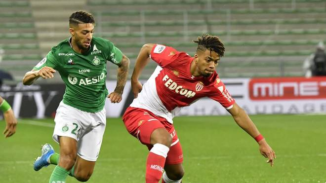 Monaco's German midfielder Benjamin Henrichs (R) fights for the ball with Saint-Etienne's Gabonese forward Denis Bouanga during the French L1 football match between AS Saint-Etienne and AS Monaco at the Geoffroy Guichard Stadium in Saint-Etienne, central France on November 3, 2019. (Photo by PHILIPPE DESMAZES / AFP) (Photo by PHILIPPE DESMAZES/AFP via Getty Images)