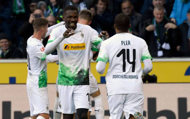 Moenchengladbach's French forward Marcus Thuram and Moenchengladbach's French forward Alassane Plea (R) celebrate celebrate scoring during the German first division Bundesliga football match Borussia Moenchengladbach v Werder Bremen in Moenchengladbach, western Germany on November 10, 2019. (Photo by INA FASSBENDER / AFP) / RESTRICTIONS: DURING MATCH TIME: DFL RULES TO LIMIT THE ONLINE USAGE TO 15 PICTURES PER MATCH AND FORBID IMAGE SEQUENCES TO SIMULATE VIDEO. == RESTRICTED TO EDITORIAL USE == FOR FURTHER QUERIES PLEASE CONTACT DFL DIRECTLY AT + 49 69 650050 (Photo by INA FASSBENDER/AFP via Getty Images)