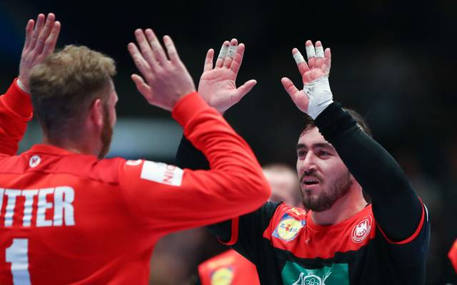 VIENNA, AUSTRIA - JANUARY 20: Johannes Bitter of Germany celebrates with Jannik Kohlbacher during the Men's EHF EURO 2020 main round group I match between Austria and Germany at Wiener Stadthalle on January 20, 2020 in Vienna, Austria. (Photo by Martin Rose/Bongarts/Getty Images)