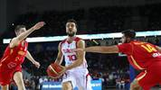 Turkey's guard Melih Mahmutoglu (C) fights for the ball with Montenegro's centre Bojan Dublijevic (R)during the 2019 FIBA Basketball World Championship European qualifying group match between Turkey and Montenegro at The Ankara Sports Hall in Ankara on September 14, 2018. (Photo by ADEM ALTAN / AFP)        (Photo credit should read ADEM ALTAN/AFP/Getty Images)