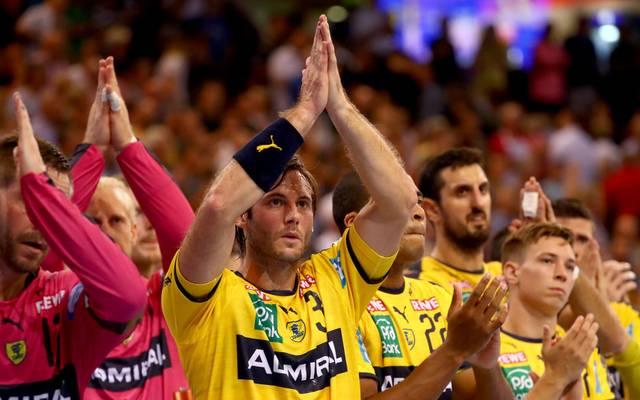 Uwe Gensheimer und die Löwen feiern einen wichtigen Sieg im Topspiel