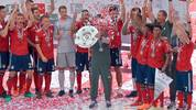 Bayern Munich's German head coach Jupp Heynckes lifts the trophy during the celebration for the 28th German football championship after the German first division Bundesliga football match FC Bayern Munich vs VfB Stuttgart in Munich, southern Germany, on May 12, 2018. (Photo by Guenter SCHIFFMANN / AFP) / RESTRICTIONS: DURING MATCH TIME: DFL RULES TO LIMIT THE ONLINE USAGE TO 15 PICTURES PER MATCH AND FORBID IMAGE SEQUENCES TO SIMULATE VIDEO. == RESTRICTED TO EDITORIAL USE == FOR FURTHER QUERIES PLEASE CONTACT DFL DIRECTLY AT + 49 69 650050        (Photo credit should read GUENTER SCHIFFMANN/AFP via Getty Images)
