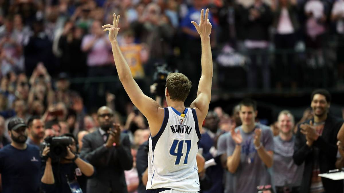 DALLAS, TX - MARCH 07:  Dirk Nowitzki #41 of the Dallas Mavericks celebrates after scoring his 30,000 career point in the second quarter against the Los Angeles Lakers at American Airlines Center on March 7, 2017 in Dallas, Texas.  NOTE TO USER: User expressly acknowledges and agrees that, by downloading and/or using this photograph, user is consenting to the terms and conditions of the Getty Images License Agreement.  (Photo by Ronald Martinez/Getty Images)