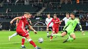 MOENCHENGLADBACH, GERMANY - NOVEMBER 16: Denis Laptev of Belarus shoots but the shot is saved by Manuel Neuer of Germany during the UEFA Euro 2020 Group C Qualifier match between Germany and Belarus on November 16, 2019 in Moenchengladbach, Germany. (Photo by Jörg Schüler/Bongarts/Getty Images)