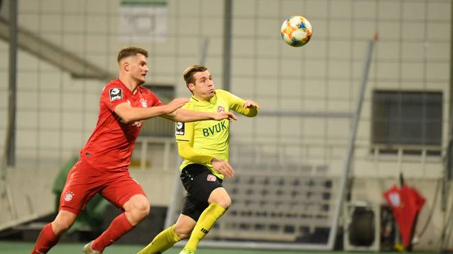 MUNICH, GERMANY - DECEMBER 22: Lars Lukas Maiof Bayern Muenchen II and Dominik Widemannof Wuerzburger Kickers compete for the ball during the 3. Liga match between Bayern Muenchen II and FC Wuerzburger Kickers at Stadion an der Gruenwalder Straße on December 22, 2019 in Munich, Germany. (Photo by Sebastian Widmann/Getty Images for DFB)