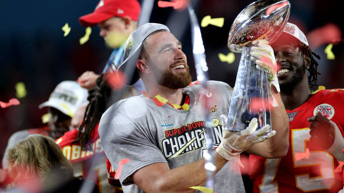 MIAMI, FLORIDA - FEBRUARY 02: Travis Kelce #87 of the Kansas City Chiefs celebrates with the Vince Lombardi Trophy after defeating the San Francisco 49ers 31-20 in Super Bowl LIV at Hard Rock Stadium on February 02, 2020 in Miami, Florida. (Photo by Maddie Meyer/Getty Images)