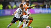 HAMBURG, GERMANY - SEPTEMBER 06: Denzel Dumfries of the Netherlands is challenged by Joshua Kimmich of Germany during the UEFA Euro 2020 qualifier match between Germany and Netherlands at Volksparkstadion on September 06, 2019 in Hamburg, Germany. (Photo by Matthias Hangst/Bongarts/Getty Images)