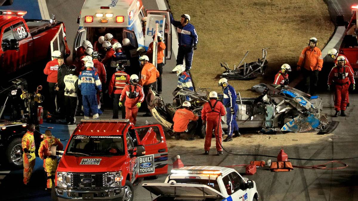 DAYTONA BEACH, FLORIDA - FEBRUARY 17:  Track workers attend to Ryan Newman, driver of the #6 Koch Industries Ford, following a crash during the NASCAR Cup Series 62nd Annual Daytona 500 at Daytona International Speedway on February 17, 2020 in Daytona Beach, Florida. (Photo by Mike Ehrmann/Getty Images)