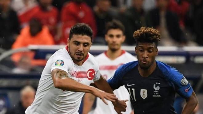 Turkey's midfielder Ozan Turfan (L) vies with France's forward Kingsley Coman during the Euro 2020 Group H qualification football match between France and Turkey at the Stade de France in Saint-Denis, outside Paris on October 14, 2019. (Photo by Alain JOCARD / AFP) (Photo by ALAIN JOCARD/AFP via Getty Images)
