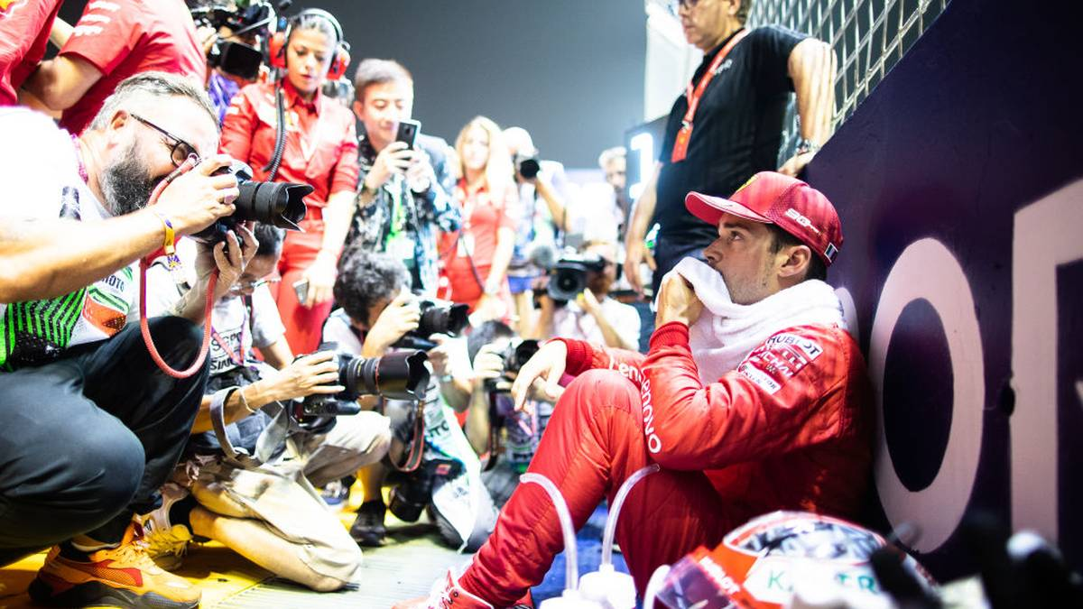 SINGAPORE, SINGAPORE - SEPTEMBER 22: Charles Leclerc of Monaco and Ferrari prepares to drive on the grid before the F1 Grand Prix of Singapore at Marina Bay Street Circuit on September 22, 2019 in Singapore. (Photo by Lars Baron/Getty Images)