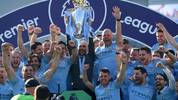 BRIGHTON, ENGLAND - MAY 12: Josep Guardiola, Manager of Manchester City celebrates with the Premier League Trophy after winning the title during the Premier League match between Brighton & Hove Albion and Manchester City at American Express Community Stadium on May 12, 2019 in Brighton, United Kingdom. (Photo by Mike Hewitt/Getty Images)
