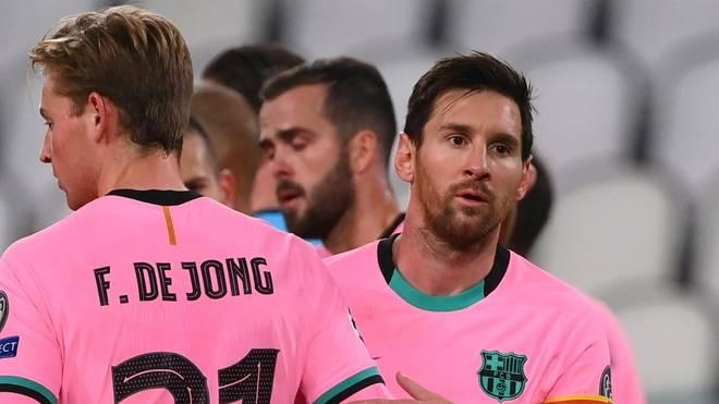 Lionel Messi (l.) und Co. konnten sich mit dem FC Barcelona finanziell einigen