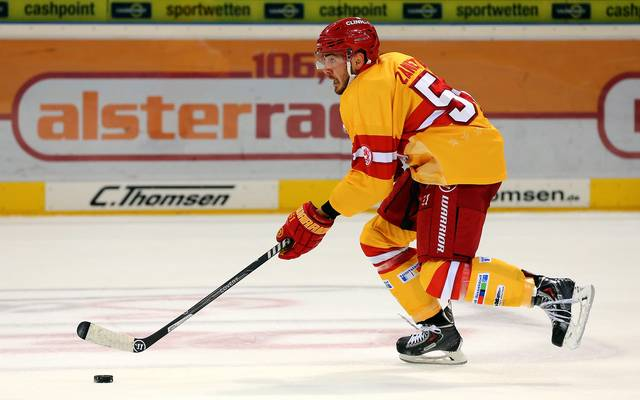 HAMBURG, GERMANY - SEPTEMBER 20: Marc Zanetti of Duesseldorf skats up the ice against the Hamburg Freezers during the DEL game between Hamburg Freezers and Duesseldorfer EG at O2 World on September 20, 2013 in Hamburg, Germany.  (Photo by Martin Rose/Bongarts/Getty Images)