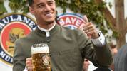 Bayern Munich's Brazilian midfielder Philippe Coutinho wears a traditional Bavarian dress as he poses during his football club's annual visit at the Oktoberfest beer festival in Munich, southern Germany, on October 6, 2019. (Photo by Christof STACHE / AFP) (Photo by CHRISTOF STACHE/AFP via Getty Images)