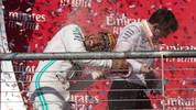 TOPSHOT - Lewis Hamilton (L) of the Mercedes AMG Petronas F1 Team celebrates following the F1 Grand Prix of USA at Circuit of The Americas in Austin, Texas on November 03, 2019. (Photo by SUZANNE CORDEIRO / AFP) (Photo by SUZANNE CORDEIRO/AFP via Getty Images)