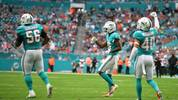 MIAMI, FLORIDA - DECEMBER 22: (L-R) Davon Godchaux #56, Steven Parker #26 an d Nik Needham #40 of the Miami Dolphins celebrate the stop against the Cincinnati Bengals in the second quarter at Hard Rock Stadium on December 22, 2019 in Miami, Florida. (Photo by Mark Brown/Getty Images)