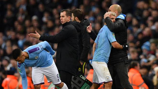 Manchester City's Spanish manager Pep Guardiola (R) hugs Manchester City's Argentinian striker Sergio Aguero as he leaves the pitch after being substituted off for Manchester City's Brazilian striker Gabriel Jesus (L) during the English League Cup semi-final second leg football match between Manchester City and Manchester United at the Etihad Stadium in Manchester, north west England, on January 29, 2020. (Photo by Paul ELLIS / AFP) / RESTRICTED TO EDITORIAL USE. No use with unauthorized audio, video, data, fixture lists, club/league logos or 'live' services. Online in-match use limited to 120 images. An additional 40 images may be used in extra time. No video emulation. Social media in-match use limited to 120 images. An additional 40 images may be used in extra time. No use in betting publications, games or single club/league/player publications. /  (Photo by PAUL ELLIS/AFP via Getty Images)
