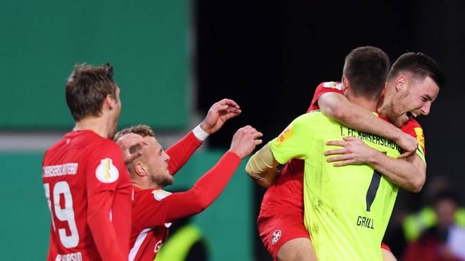 KAISERSLAUTERN, GERMANY - OCTOBER 30: Lennart Grill of 1. FC Kaiserslautern is congratulated after a penalty shoot out by his team mates during the DFB Cup second round match between 1. FC Kaiserslautern and 1. FC Nuernberg at Fritz-Walter-Stadion on October 30, 2019 in Kaiserslautern, Germany. (Photo by Alex Grimm/Bongarts/Getty Images)
