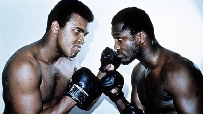 Joe Frazier (r.) war Gegner von Muhammad Ali in drei legendären Kämpfen