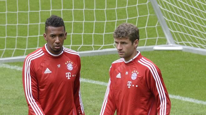 Thomas Müller (r.) und Jerome Boateng spielen gemeinsam für den FC Bayern