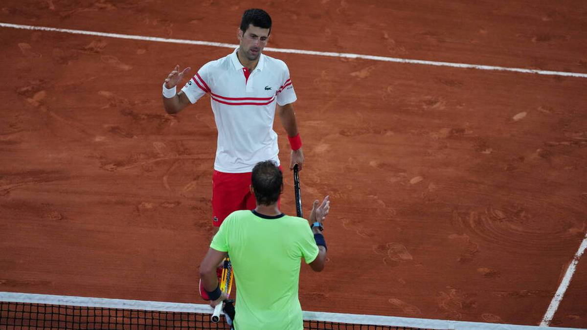 (210612) -- PARIS, June 12, 2021 -- Rafael Nadal (bottom) of Spain and Novak Djokovic of Serbia greet each other after their men s singles semifinal at the French Open tennis tournament at Roland Garros in Paris, France, June 11, 2021. ) (SP)FRANCE-PARIS-TENNIS-ROLAND GARROS-FRENCH OPEN-MEN S SINGLES-SEMIFINALS GaoxJing PUBLICATIONxNOTxINxCHN