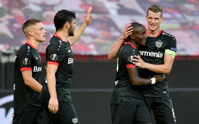 LEVERKUSEN, GERMANY - AUGUST 06: Moussa Diaby of Bayer Leverkusen celebrates with Lars Bender after scoring his sides first goal during the UEFA Europa League round of 16 second leg match between Bayer 04 Leverkusen and Rangers FC at BayArena on August 06, 2020 in Leverkusen, Germany.  (Photo by Sascha Schuermann/Pool via Getty Images)