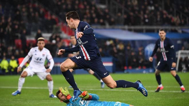 Paris Saint-Germain's German midfielder Julian Draxler jumps over Lyon's Portuguese goalkeeper Anthony Lopes during the French L1 football match between Paris Saint-Germain (PSG) and Lyon (OL) at the Parc des Princes stadium in Paris, on February 9, 2020. (Photo by FRANCK FIFE / AFP) (Photo by FRANCK FIFE/AFP via Getty Images)