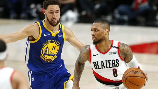 Damian Lillard (r.) spielt gegen die Golden State Warriors trotz Rippenverletzung.