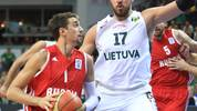 Lithuania's Jonas Valanciunas (R) vies for the ball with Russia's Alexey Shved during the friendly basketball match Lithuania vs Russia, on August 22, 2013, in Vilnius. AFP PHOTO / PETRAS MALUKAS        (Photo credit should read PETRAS MALUKAS/AFP/Getty Images)