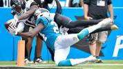 CHARLOTTE, NORTH CAROLINA - OCTOBER 06: D.J. Chark #17 of the Jacksonville Jaguars makes a diving catch against James Bradberry #24 of the Carolina Panthers during the second half of their game at Bank of America Stadium on October 06, 2019 in Charlotte, North Carolina. The Panthers won 34-27. (Photo by Grant Halverson/Getty Images)