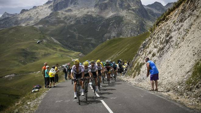 TOPSHOT - (From L) Belarus' Vasil Kiryienka, Poland's Michal Kwiatkowski, Spain's Mikel Landa, Spain's Mikel Nieve, Great Britain's Christopher Froome (hidden) wearing the overall leader's yellow jersey and Italy's Fabio Aru ride during the 183 km seventeenth stage of the 104th edition of the Tour de France cycling race on July 19, 2017 between Le La Mure and Serre-Chevalier, French Alps.  / AFP PHOTO / Lionel BONAVENTURE        (Photo credit should read LIONEL BONAVENTURE/AFP via Getty Images)